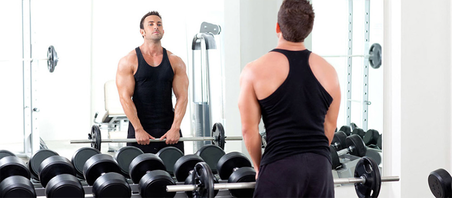 male-lifting-weights-gym-mirror.png