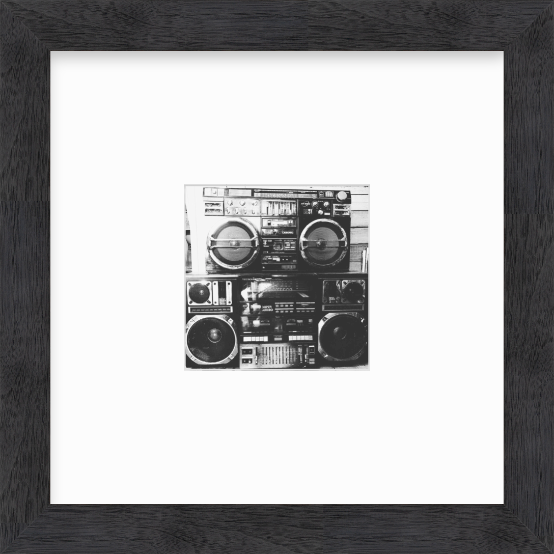 photo of boomboxes in black wood frame