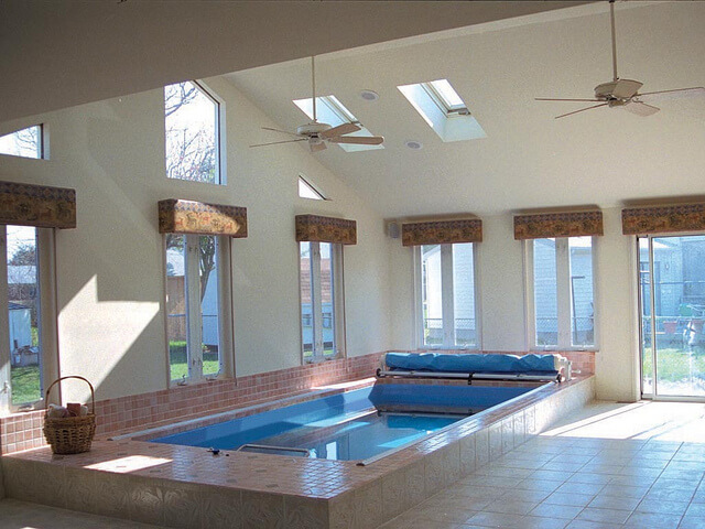 A sunroom installation of an Endless Pools swimming machine