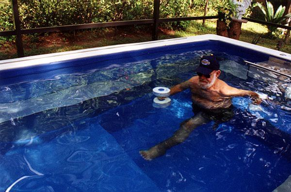 Dennis Henry in his backyard Endless Pool