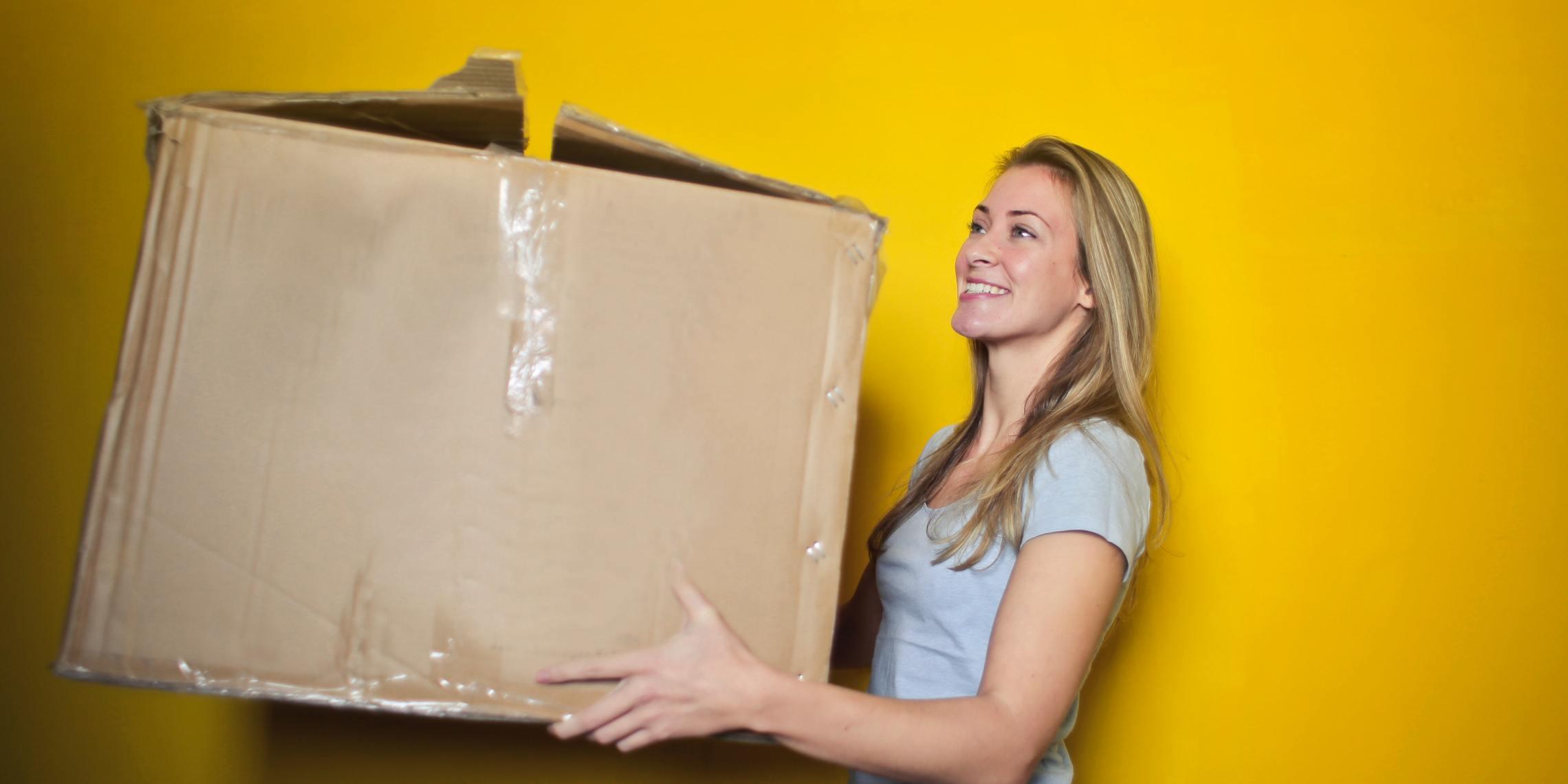 woman holding large box