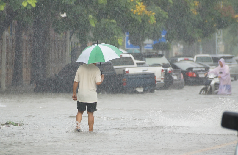 man on flooded street