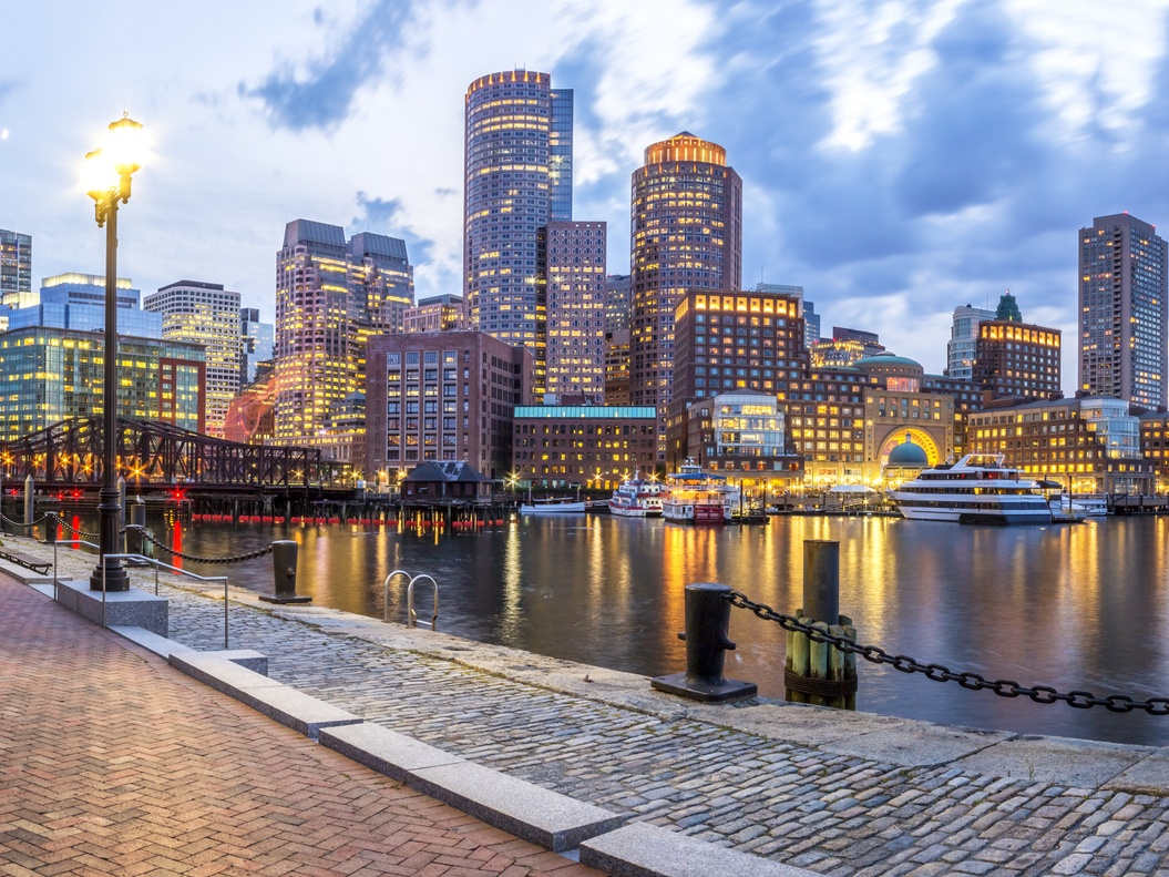 Photo of Boston skyline with river in the foreground