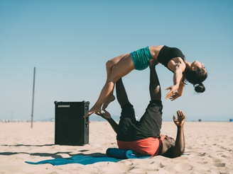 Victor doing acro on the beach