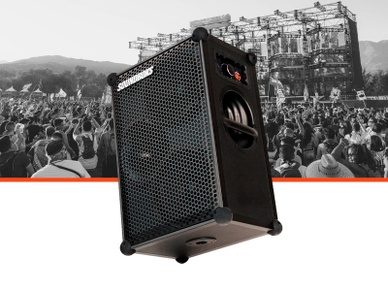 SOUNDBOKS bluetooth performance speaker with a festival background