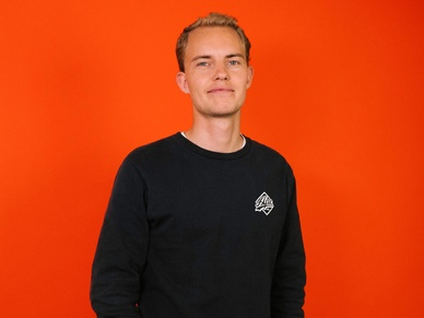 Mikkel from SOUNDBOKS on an orange background