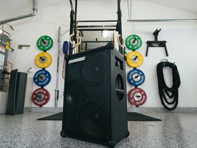 SOUNDBOKS portable bluetooth speaker in a home gym setup