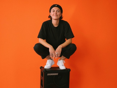 photo of student assistant, sina on top of a SOUNDBOKS