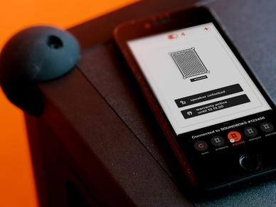 SOUNDBOKS App on an iPhone on top of the SOUNDBOKS