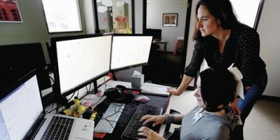 Heather Terenzio, of Techtonic Academy in Boulder, works with Jennifer Garrett on Wednesday.