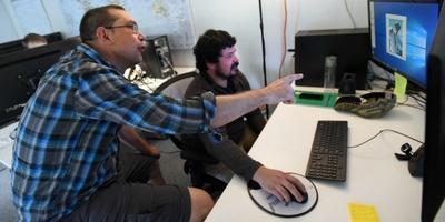 Ryan Bird, left, helps Adam Arellano with training at Techtonic Academy in Boulder.