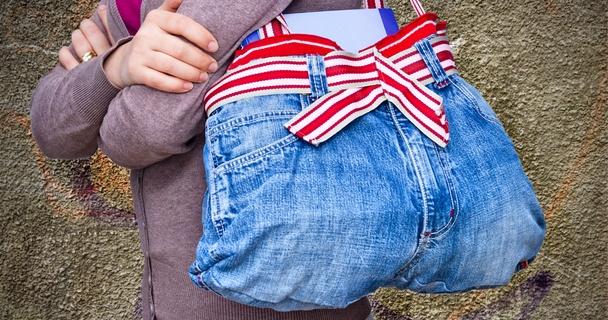 woman with a repurposed denim bag