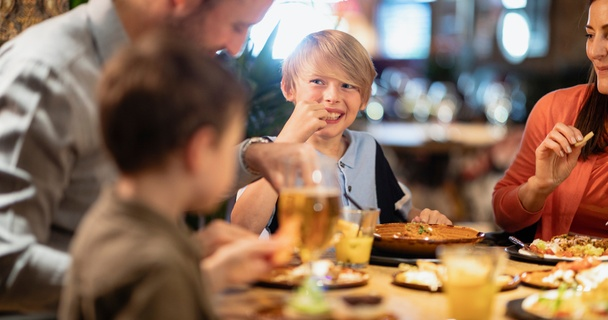 Family eating together at a pub