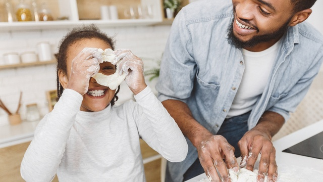 kid making pizza with dad