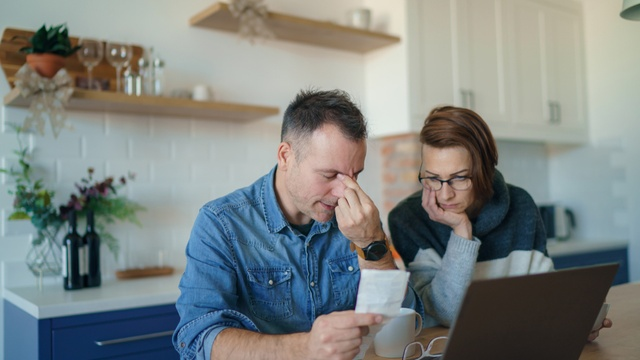 stressed couple looking at finances