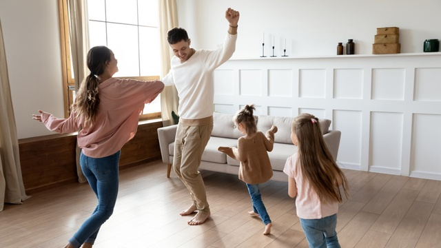 family celebrating new home in lounge