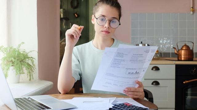 Woman checking energy bills