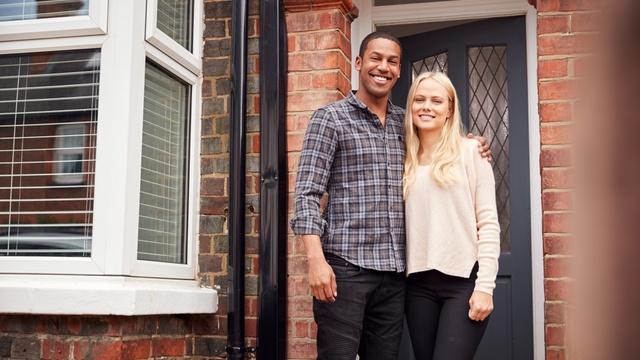 couple standing at door
