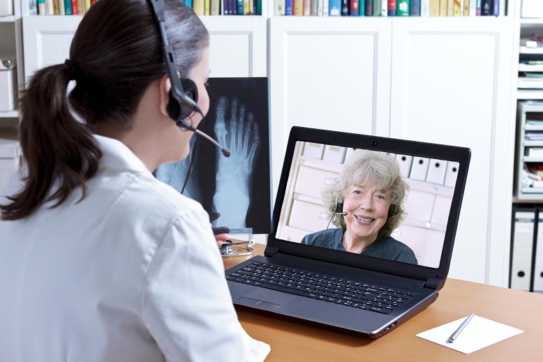 Telehealth In Home Healthcare-Senior Woman Getting Patient Care Via Telemedicine Monitoring