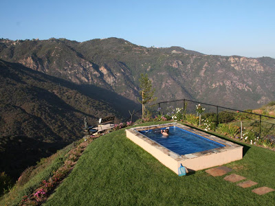 A hillside Endless Pools swimming machine installed partially in-ground