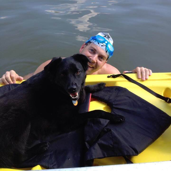 Paratriathlete Chris with his dog after an open water swim