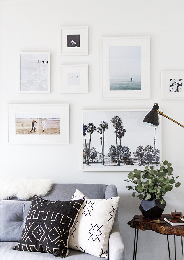 eucalyptus in living room with gallery wall and grey couch