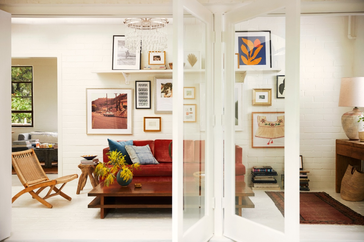 large gallery wall on white painted brick