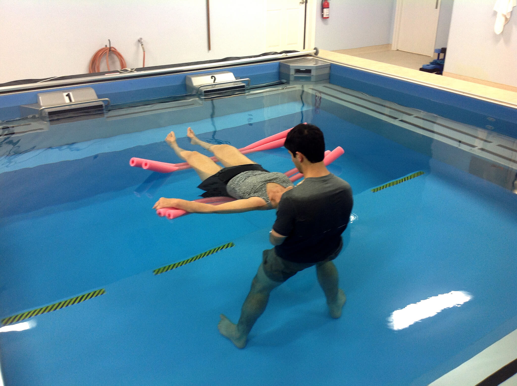 Watsu bodywork performed in a Dual Propulsion Endless Pool