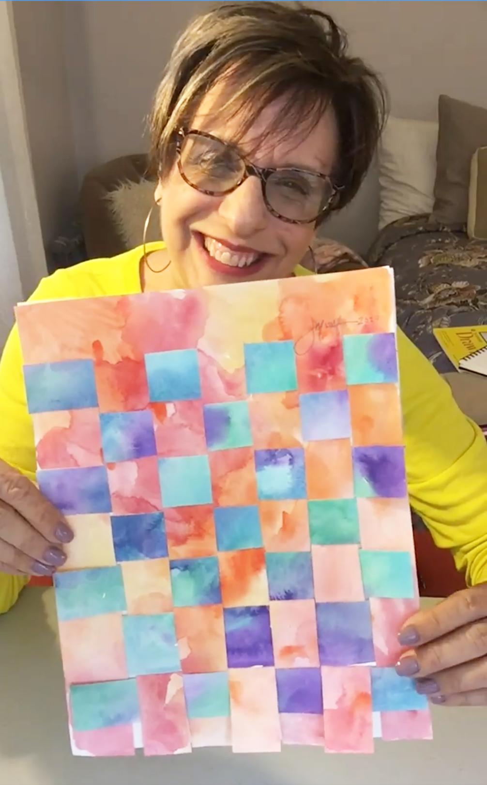 art teacher with watercolor artwork
