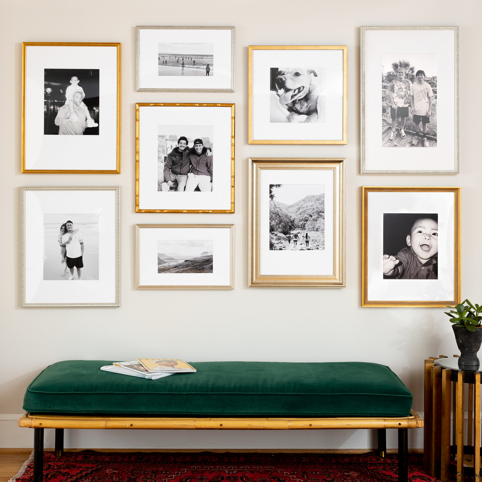 staggered grid gallery wall in metallic frames