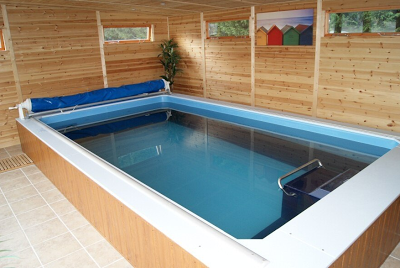 an Endless Pools swimming machine in an enclosure by Bakers Timber Buildings