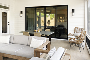 Outdoor dining and living space with sliding patio door from Infinity from Marvin