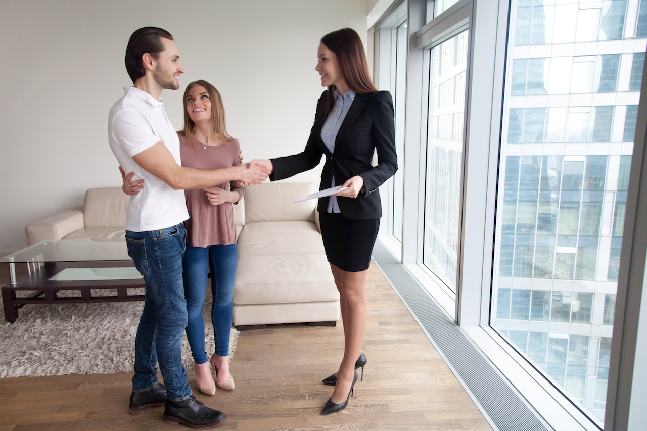 young couple talking to a realtor