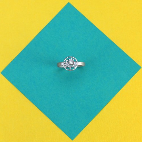 Silver structured circle link with CZ ring