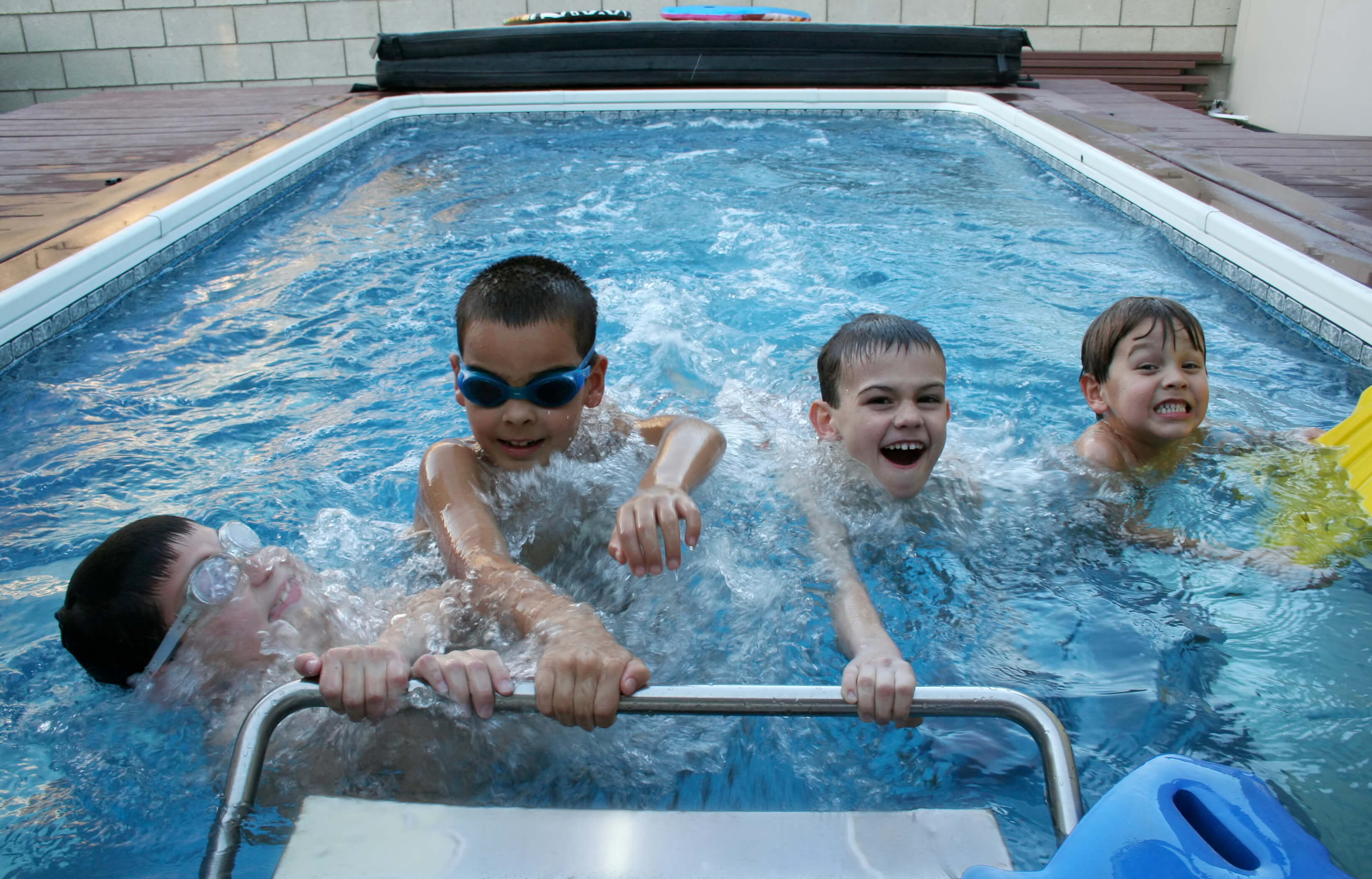 4 boys in an Original Endless Pools swimming machine
