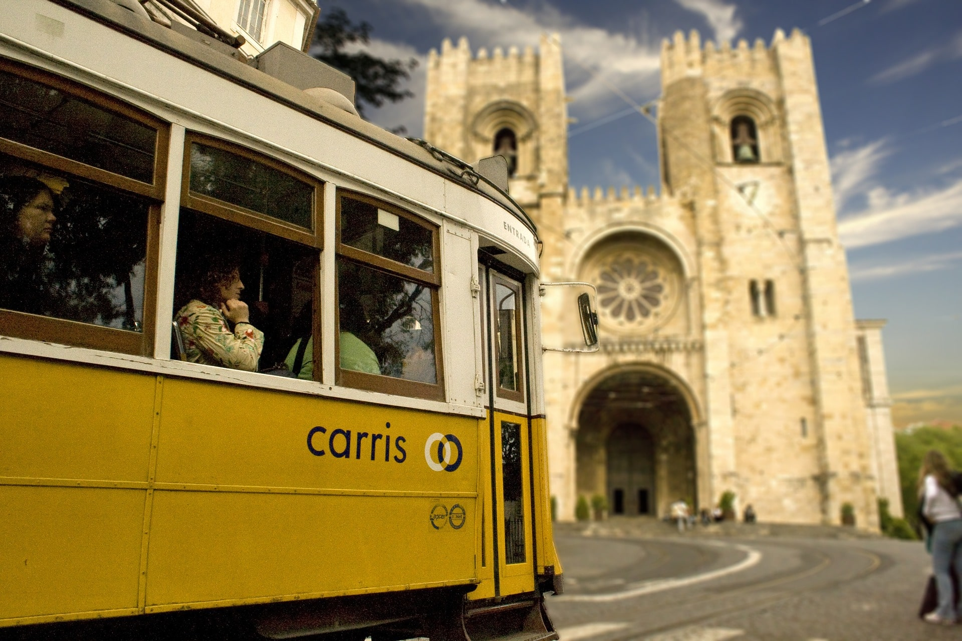 Taking a ride on Lisbon's yellow tram is a great thing to do in Portugal