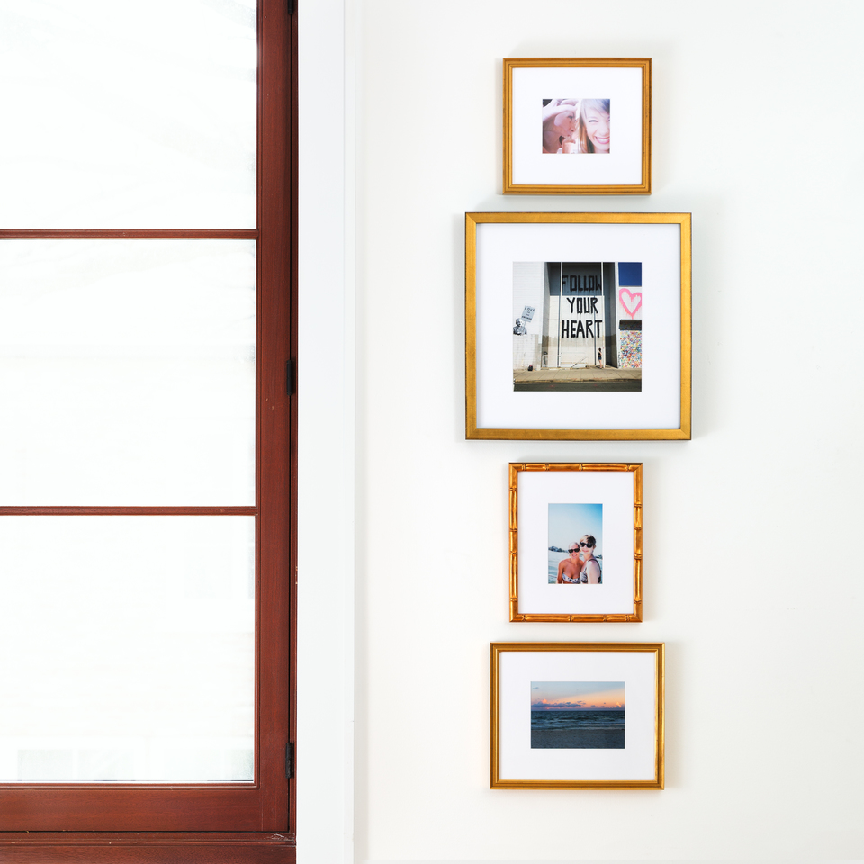 stack gallery wall in gold frames
