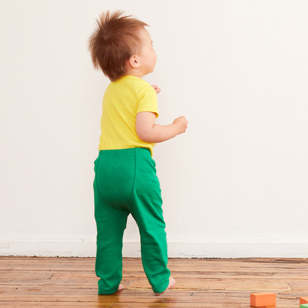 a toddler wearing green cloth diaper pants from primary.com