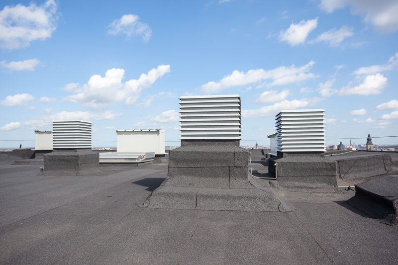 Flat gray roof with equipment