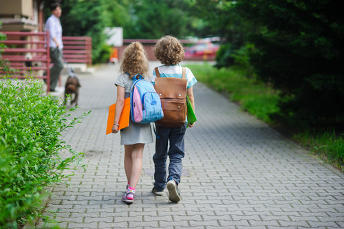 girl and a boy walking to class together