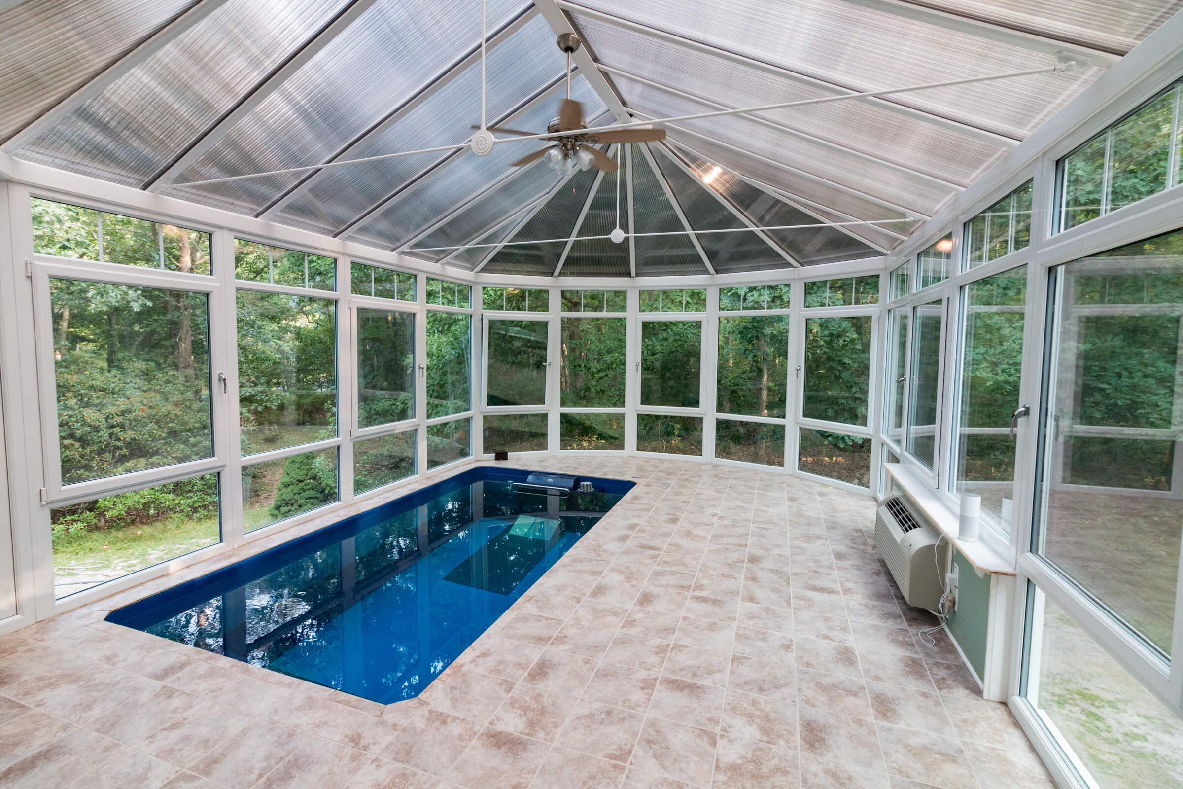 a fully in-ground Endless Pool in a conservatory
