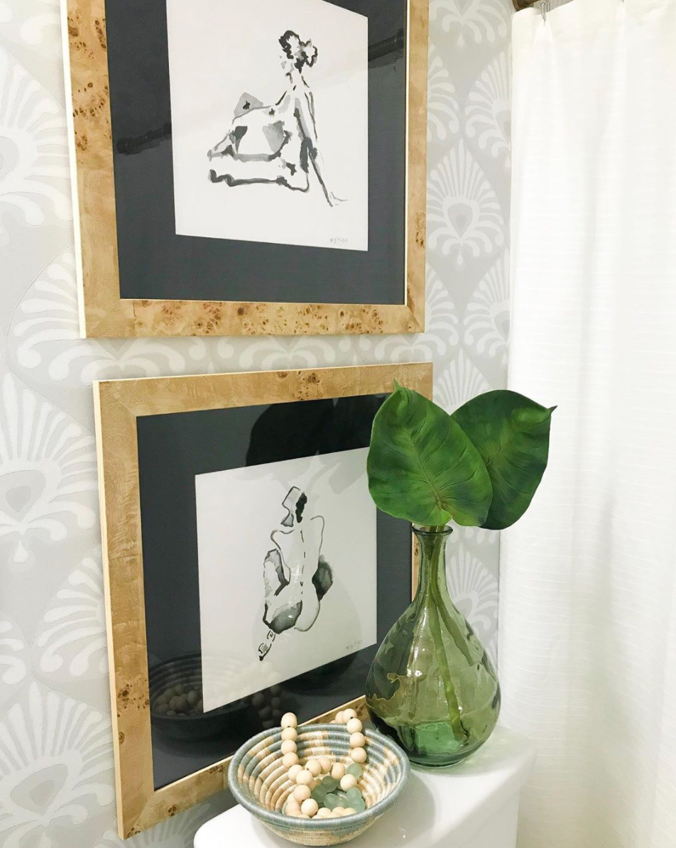 artist paintings in burlwood frames with black mats