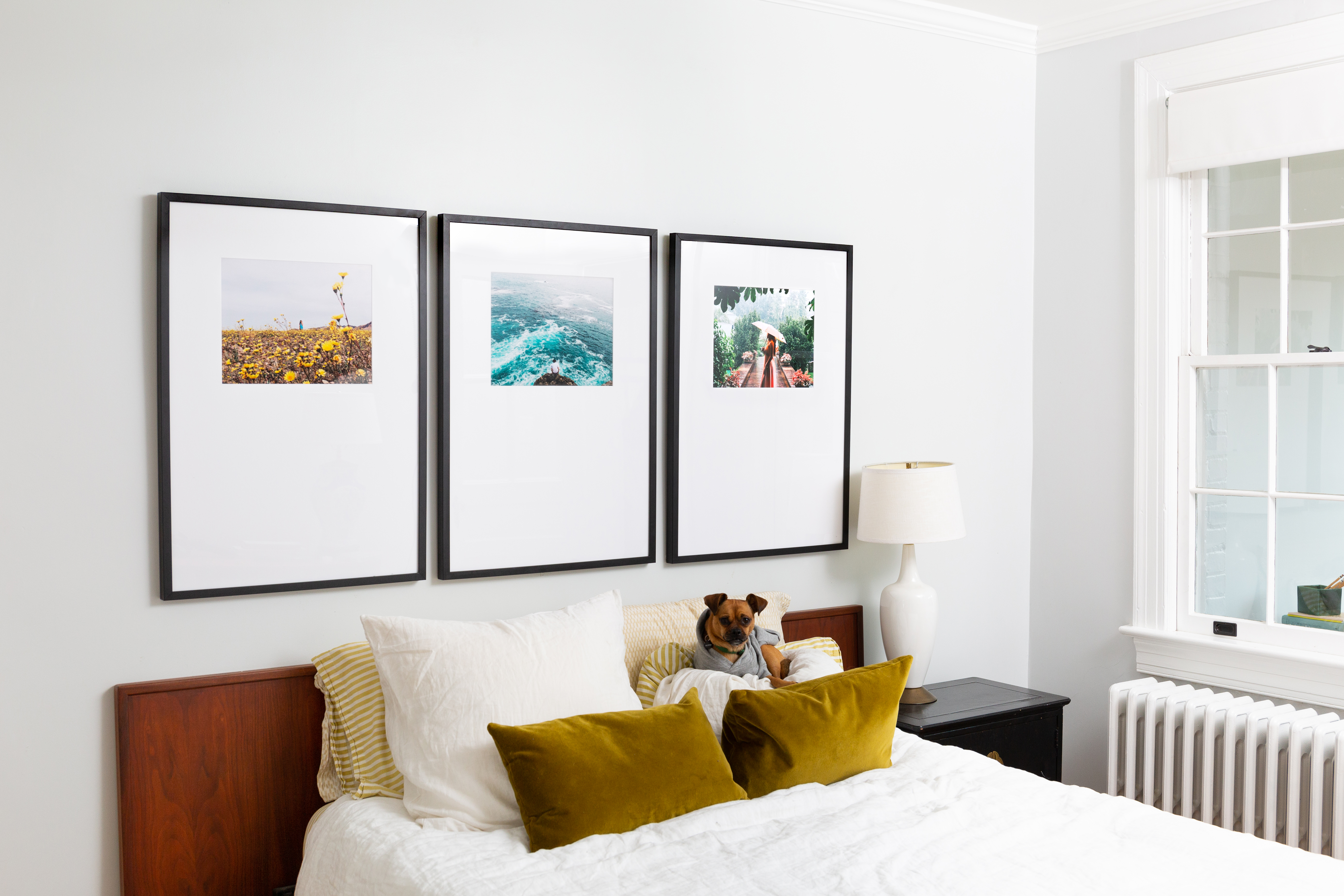 triptych gallery wall above bed