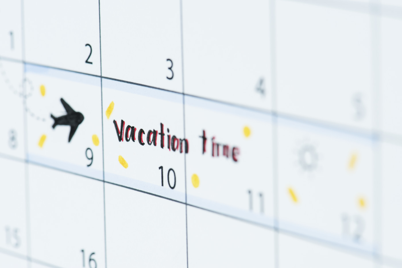 monthly calendar with a vacation week written