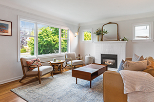 living room with fireplace and casement replacement windows