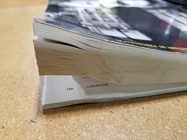 A photo of a textbook with severely stained pages