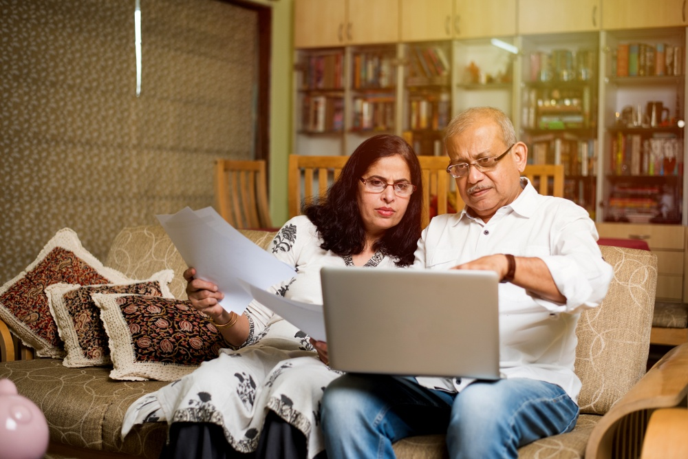 couple looking at laptop  in living room