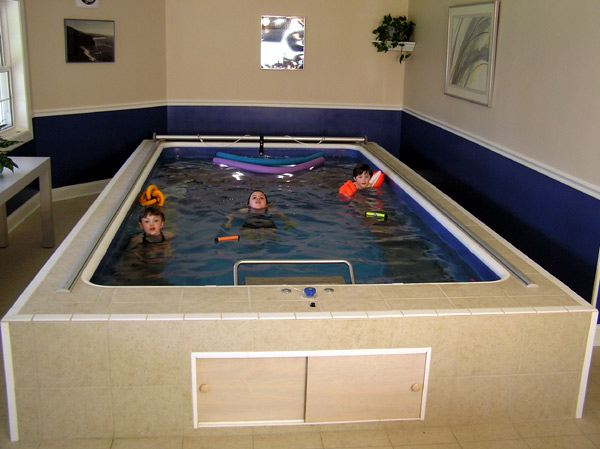 children play in an Endless Pools swimming machine