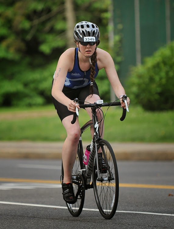 a member of Team Endless Pools cycling at the TriRock Philly triathlon
