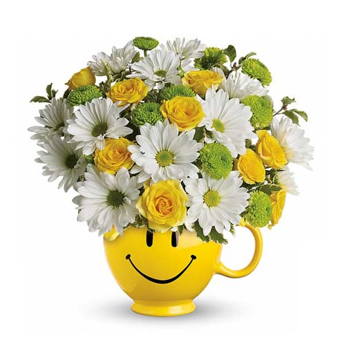 Mini yellow roses and white daisies smiley face cup bouquet